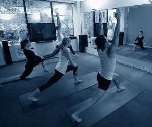 Students practicing warrior poses at Melbourne studio