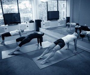 Students in reseverse plank practising yoga at Melbourne studio